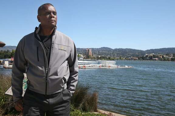 Property developer Michael Johnson is seen at Lake Merritt in Oakland, Calif. on Thursday, April 16, 2015. Johnson is hoping to build a 24-story residence tower at Lake Merritt Boulevard and East 12th Street but is facing opposition.