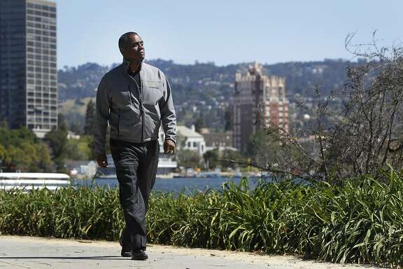 Property developer Michael Johnson walks on the path at Lake Merritt in Oakland, Calif. on Thursday, April 16, 2015. Johnson is hoping to build a 24-story residence tower at Lake Merritt Boulevard and East 12th Street but is facing opposition.
