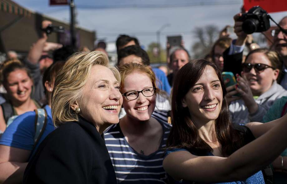 With crowds of supporters waiting for her, Hillary Clinton stopped at a coffee house in Mount Vernon, Iowa,  on Tuesday, April 14, 2015. Illustrates CLINTON (category a), by Anne Gearan and Philip Rucker (c) 2015, The Washington Post. Moved Tuesday, April 14, 2015. (MUST CREDIT: Washington Post photo by Melina Mara) Photo: Melina Mara, Washington Post