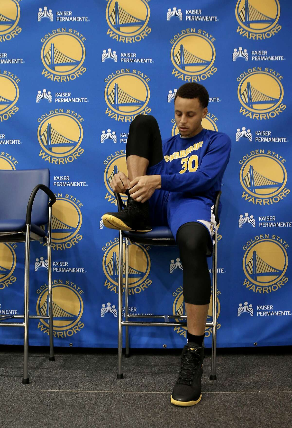 Stephen Curry gets ready for practice after being interviewed as the Golden State Warriors NBA basketball team held a media availability at their practice facility in Oakland, Calif., on Thurs. April 16, 2015, in preparation for the upcoming playoffs.