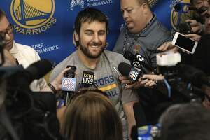 Andrew Bogut talks with reporters as the Golden State Warriors NBA basketball team holds a media availability at their practice facility in Oakland, Calif., on Thurs. April 16, 2015, in preparation for the upcoming playoffs.