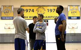 Head Coach Steve Kerr, (center) gets set for practice after the Golden State Warriors NBA basketball team held a media availability at their practice facility in Oakland, Calif., on Thurs. April 16, 2015, in preparation for the upcoming playoffs.