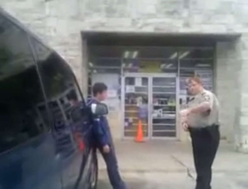 A tense encounter with police ultimately ends with a woman's arrest. Screenshot from Youtube