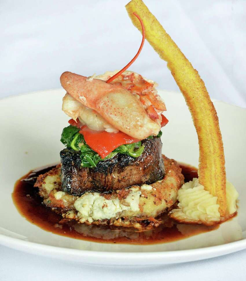 Filet and lobster Neopolitan with bleu cheese potato at Jack's Oyster House on State Street Tuesday April 14, 2015 in Albany, NY. (John Carl D'Annibale / Times Union)