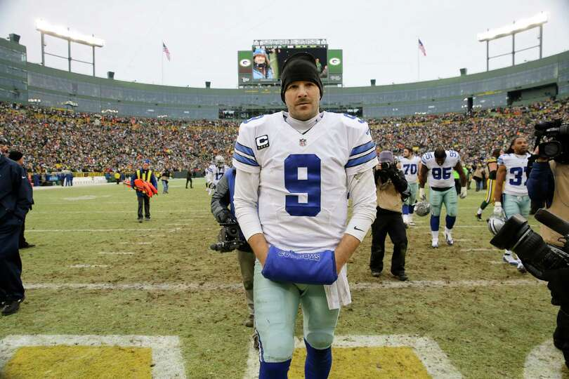 Dallas Cowboys quarterback Tony Romo (9) walks off the field after an NFL divisional playoff footbal