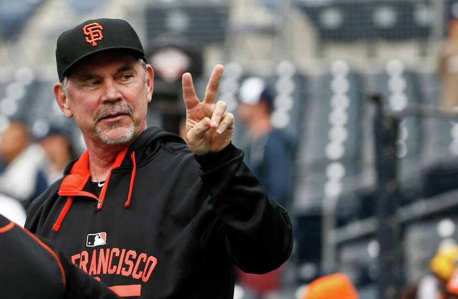 San Francisco Giants manager Bruce Bochy gestures to fans prior to a baseball game against the San Diego Padres, Friday, April 10, 2015, in San Diego. (AP Photo/Lenny Ignelzi) Photo: Lenny Ignelzi / Associated Press / AP