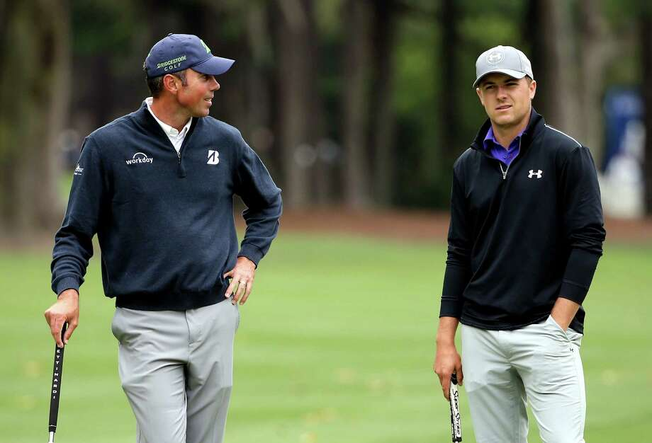 A grim-faced Jordan Spieth (right) chats with Matt Kuchar during their round. Photo: Streeter Lecka / Getty Images / 2015 Getty Images