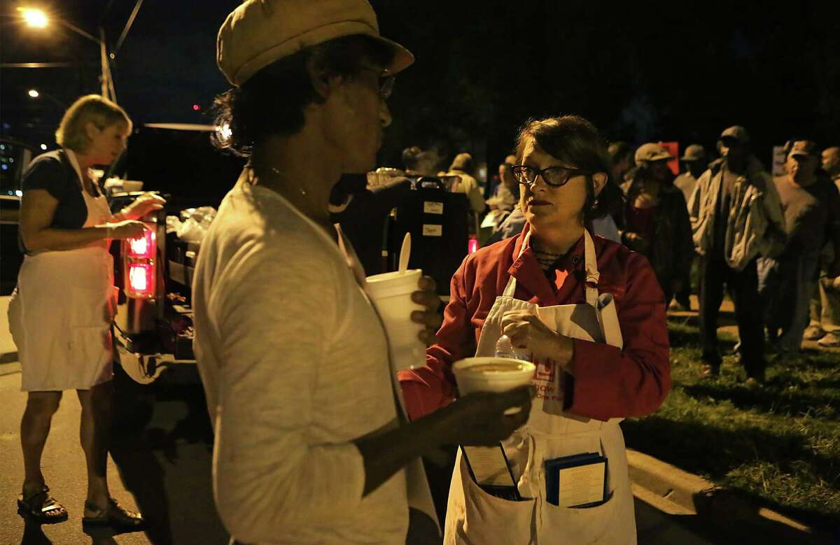 Joan Cheever, right, was given a ticket by San Antonio Police on April 7, for serving food without a proper permit in Maverick Park. The following week, April 14, Cheever showed up again to feed the homeless as she does every Tuesday night, but this time she was joined by more than 50 supporters.