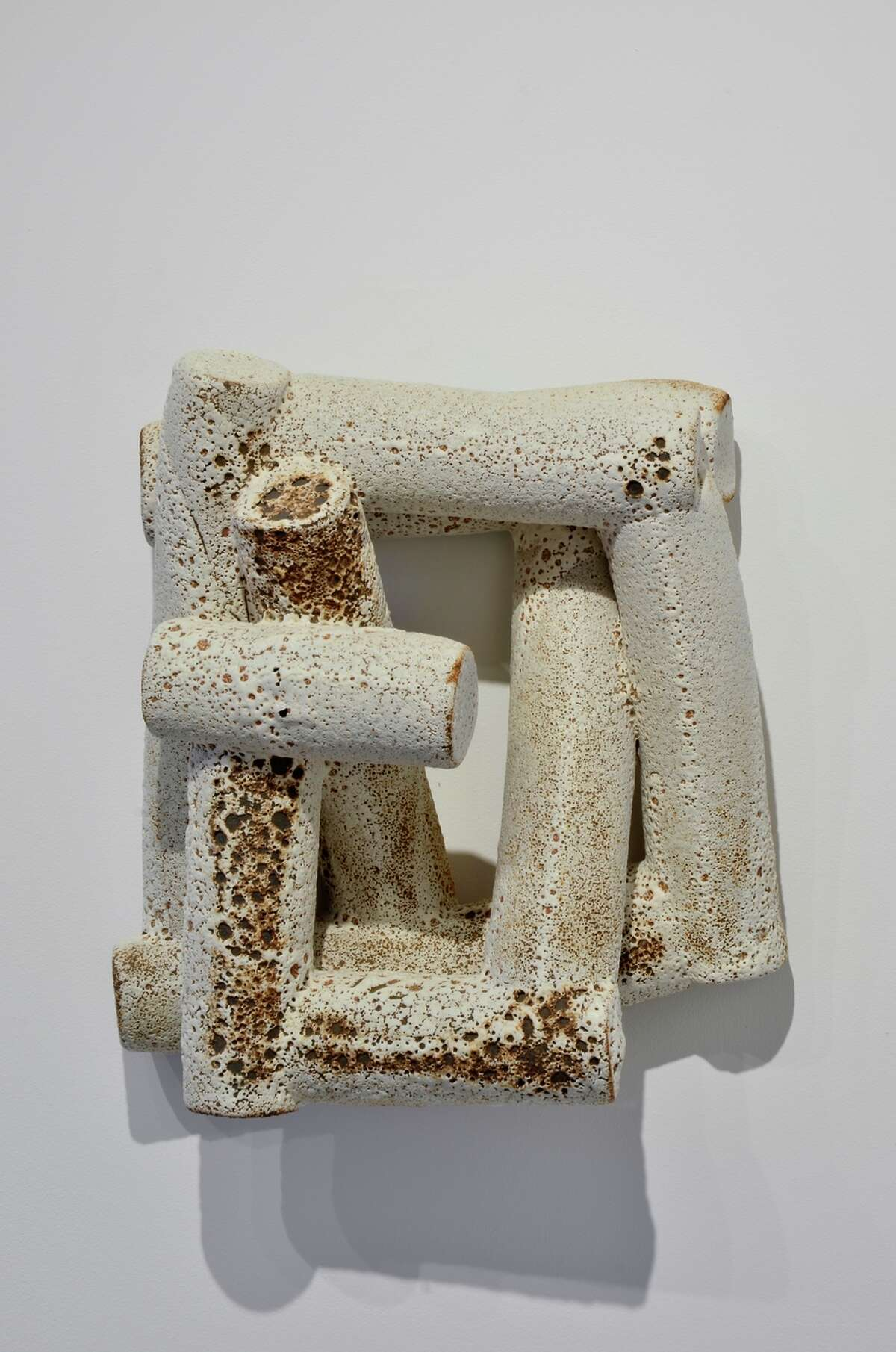 """Robert Brady's wood and paint """"Bode,"""" left, and ceramic """"Language Series ... LS05"""" (both 2015) are at Jack Fischer Gallery."""
