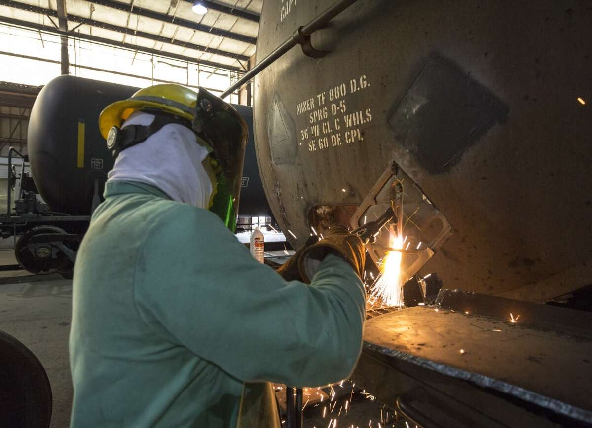 NTSB Chairman Christopher Hart tours the GBW Railcar Services factory at 17000 Premium Drive, Hockley, Texas, today. GBX workers retrofit standard DOT-111 tank cars and other cars to higher standards. Thursday April 16, 2015 (Craig H. Hartley/For the Chronicle)