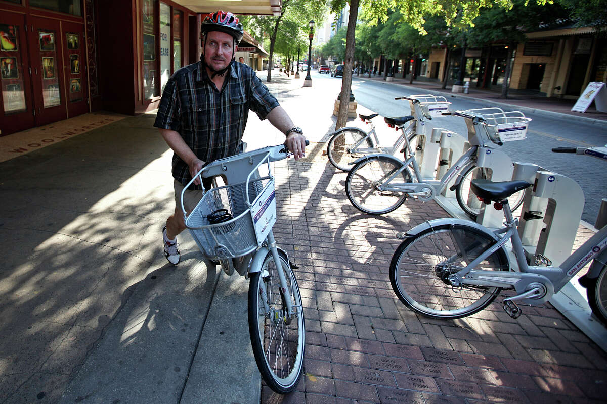 Philip Schrank, owner of Gallery Vetro, takes off on a B-Cycle bike to ride home at the East Houston Street stand June 23, 2011. Schrank is the #1 user of the B-Cycle bike-sharing system with around 750 miles. ANDREW BUCKLEY / abuckley@express-news.net