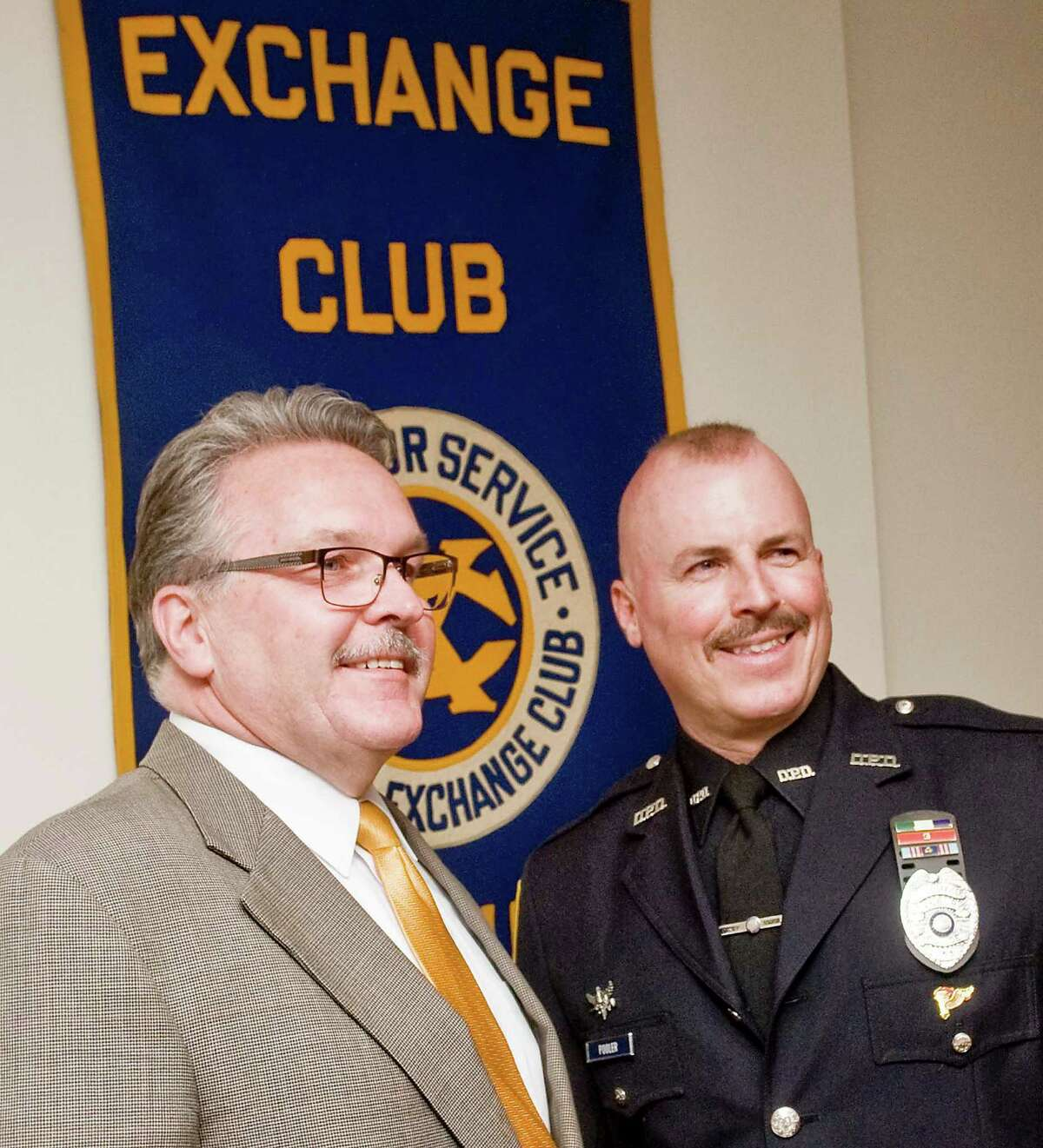 Danbury Mayoral Assistant Dean Esposito with his cousing Danbury police Officer Joseph Pooler who is being honored as City of Danbury Police Officer of the Year by The Exchange Club of Danbury at Anthonyís Lake Club in Danbury. Thursday, April 16, 2015
