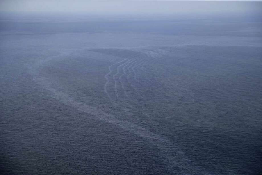 This March 31, 2015 photo shows an oil sheen drifting from the site of the former Taylor Energy oil rig in the Gulf of Mexico, off the coast of Louisiana.  (AP Photo/Gerald Herbert) Photo: Gerald Herbert, STF / AP