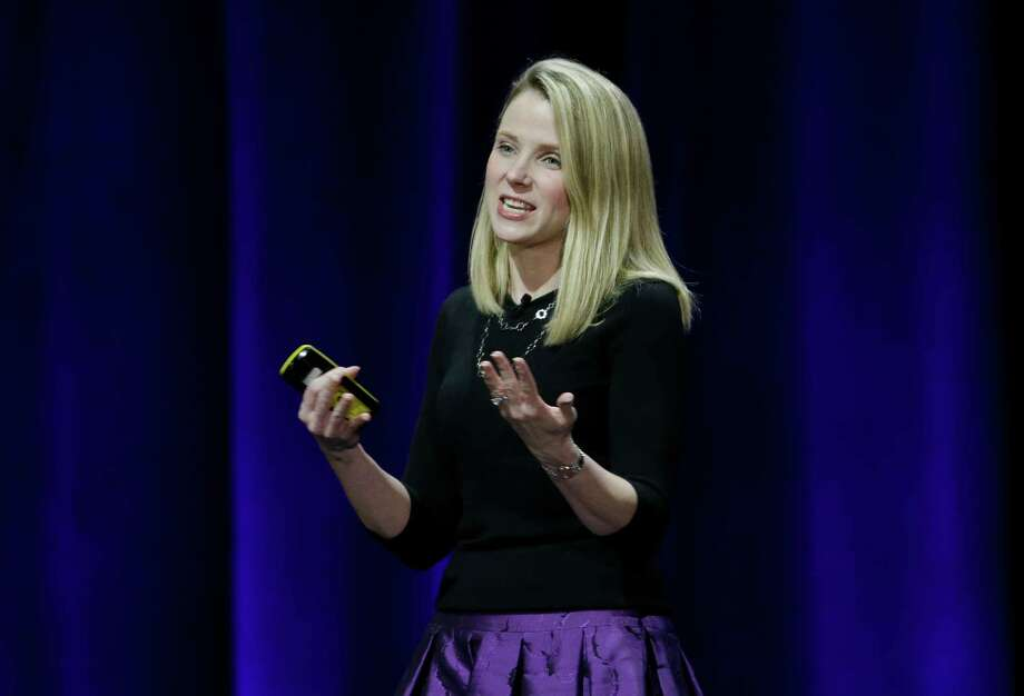 This Feb. 19, 2015 photo, Yahoo President and CEO Marissa Mayer delivers the keynote address at the first-ever Yahoo Mobile Developer Conference in San Francisco.  Yahoo and Microsoft will keep working together on search, but Yahoo is getting more control over the how its search page looks and works. An agreement announced Thursday, April 16, 2015 extends a search partnership that Yahoo Inc. and Microsoft Corp. forged in 2009 while they were being led by different CEOs. Yahoo had an option of ending the relationship. The two are trying to chip away at Google's dominance of Internet search. (AP Photo/Eric Risberg) ORG XMIT: NY119 Photo: Eric Risberg / AP