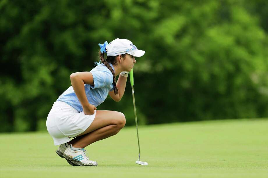 Johnson's Taylor Coleman reads the green for a putt at the Region IV-6A high school girls golf tournament at Brackenridge Park Golf Course on Thursday, Apr. 16, 2015. Coleman finished first with a two-round total of 141 to advance to the state tournament.  (Kin Man Hui/San Antonio Express-News) Photo: Kin Man Hui, Staff / San Antonio Express-News / ©2015 San Antonio Express-News