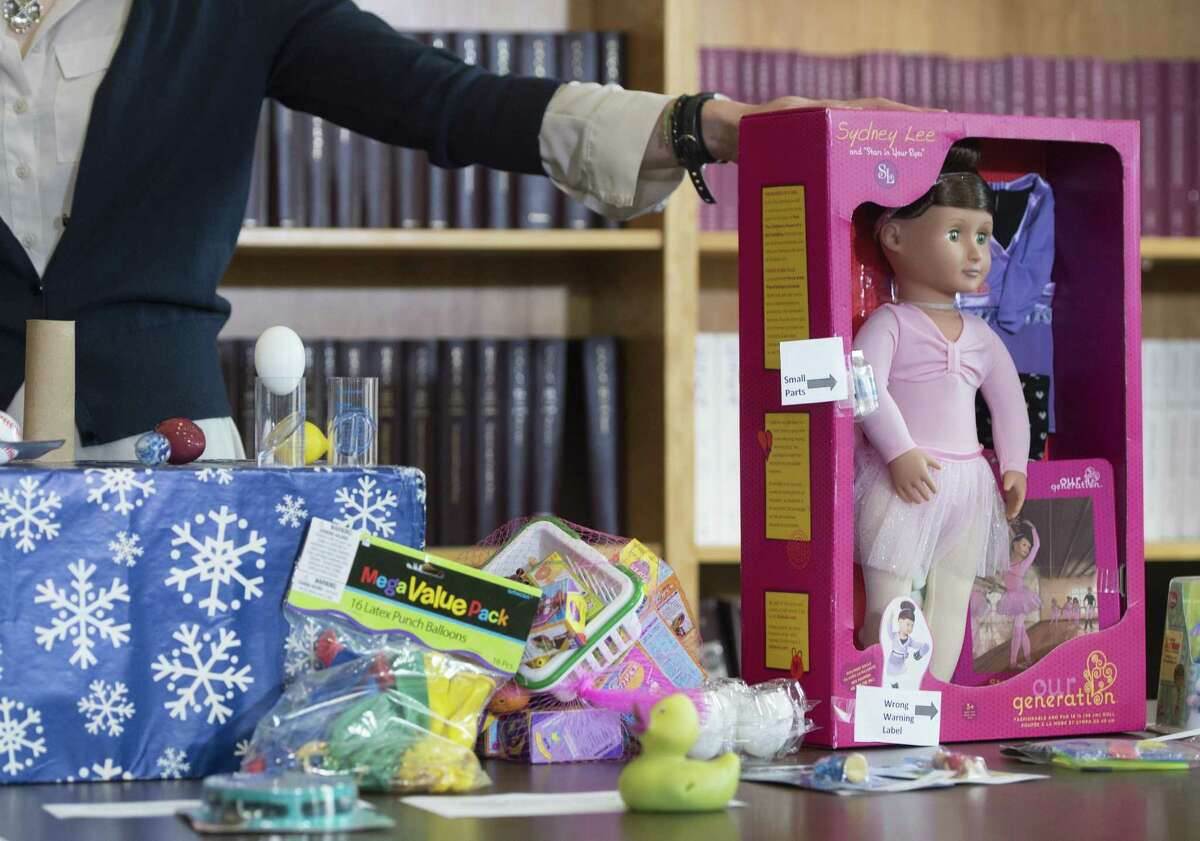 Examples of unsafe toys are shown during a press conference at the US Public Interest Group as they release the 29th annual Trouble in Toyland report about dangerous or toxic toys in Washington, DC, December 1, 2014. The report reveals the results of laboratory testing on toys for toxic chemicals, including lead, chromium and phthalates, as well as examples of toys that pose chocking hazards, extremely loud toys that can lead to hearing loss and powerful toy magnets which can cause serious injury if swallowed. (AFP PHOTO / Saul LOEBSAUL LOEB/AFP/Getty Images)