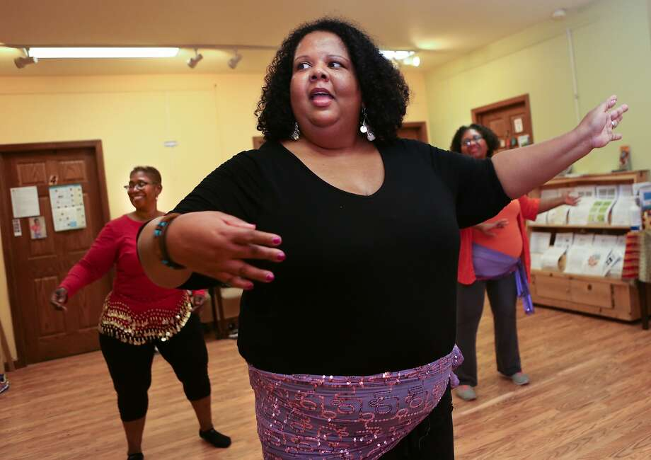 Instructor Etang (center) Inyang of Raks Africa teaches a belly dancing class while students, Asha Enam (left) and JoAnn Teer, follow along in Oakland, Calif., on Tuesday, April, 14, 2015. Photo: Amy Osborne, The Chronicle