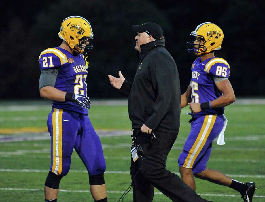 UAlbany football head coach Gegg Gattuso, center, with players #21 Nic Ketter and #85 Brad Harris, right during Saturday's Colonial Athletic Association game against James Madison at University at Albany's Bob Ford Field Oct. 4, 2014, in Albany, NY.  (John Carl D'Annibale / Times Union) Photo: John Carl D'Annibale / 00028860A