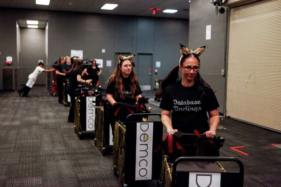 The librarians from Texas State University preparing to take to the dance floor at the Annual Book Cart Drill Team Competition, back after a few years of dormancy showcasing Librarians from all over Texas. The teams showed off their dance skills with elaborate routines incorporating book carts Thursday, April 9, 2015 at the Austin Convention Center. Photo: Spencer Selvidge For The San Ant, Spencer Selvidge / Copyright 2015, Spencer Selvidge for the San Antonio Express-News