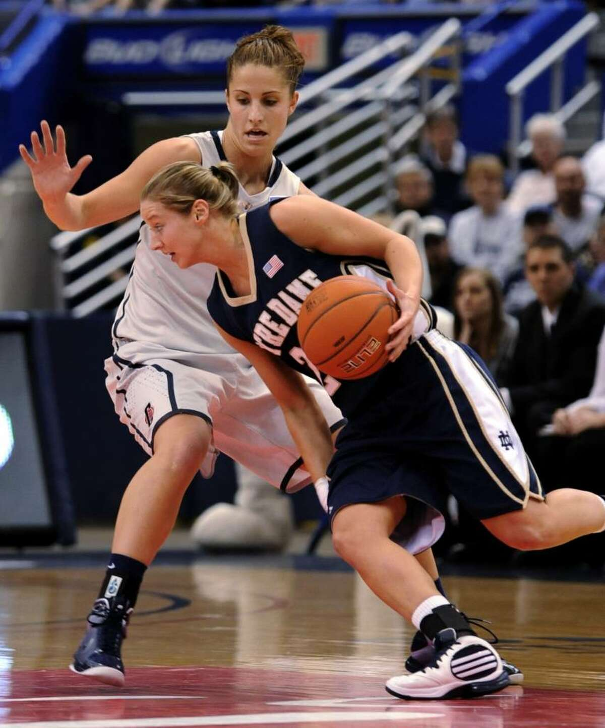 Notre Dame's Melissa Lechlitner takes the ball past Connecticut's Caroline Doty during the first half of an NCAA college basketball game in the semifinals of the Big East tournament in Hartford, Conn., Monday, March 8, 2010. (AP Photo/Bob Child)
