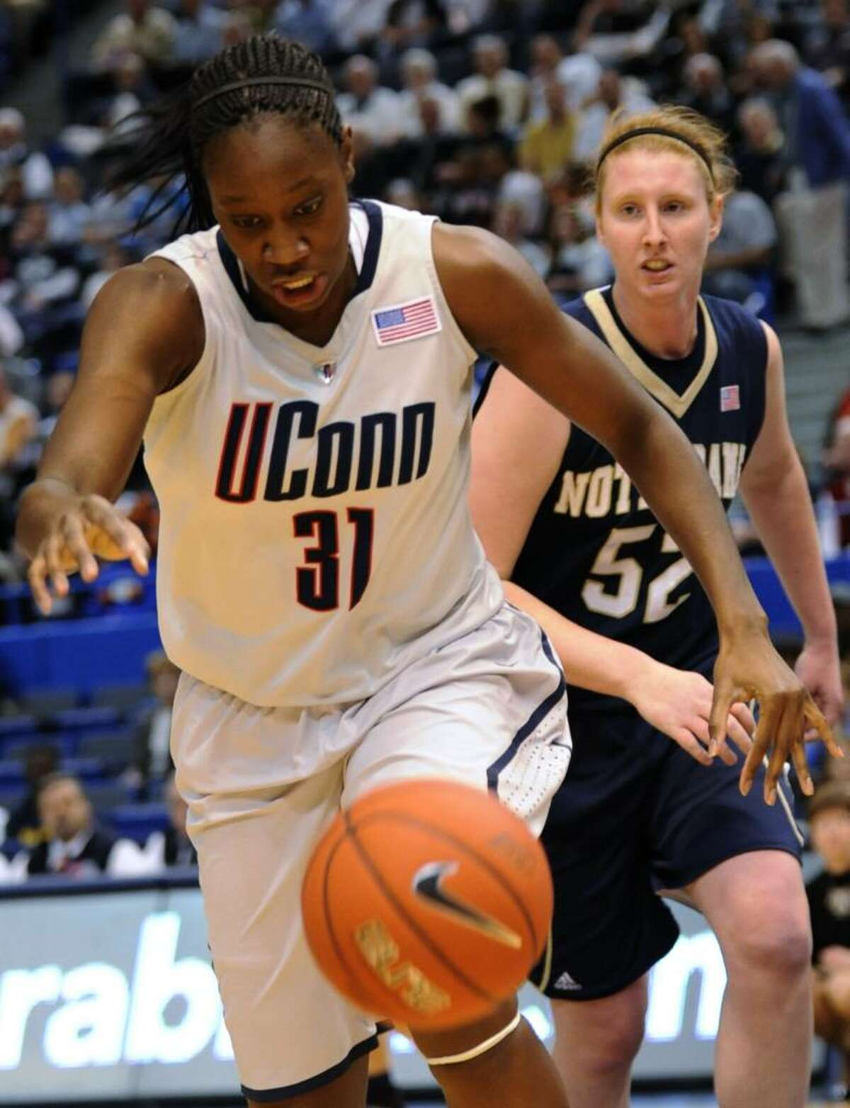 Connecticut's Tina Charles, left, and Notre Dame's Erica Wiliamson go after a loose ball during the first half of an NCAA college basketball game in the semifinals of the Big East tournament in Hartford, Conn., Monday, March 8, 2010. (AP Photo/Bob Child)
