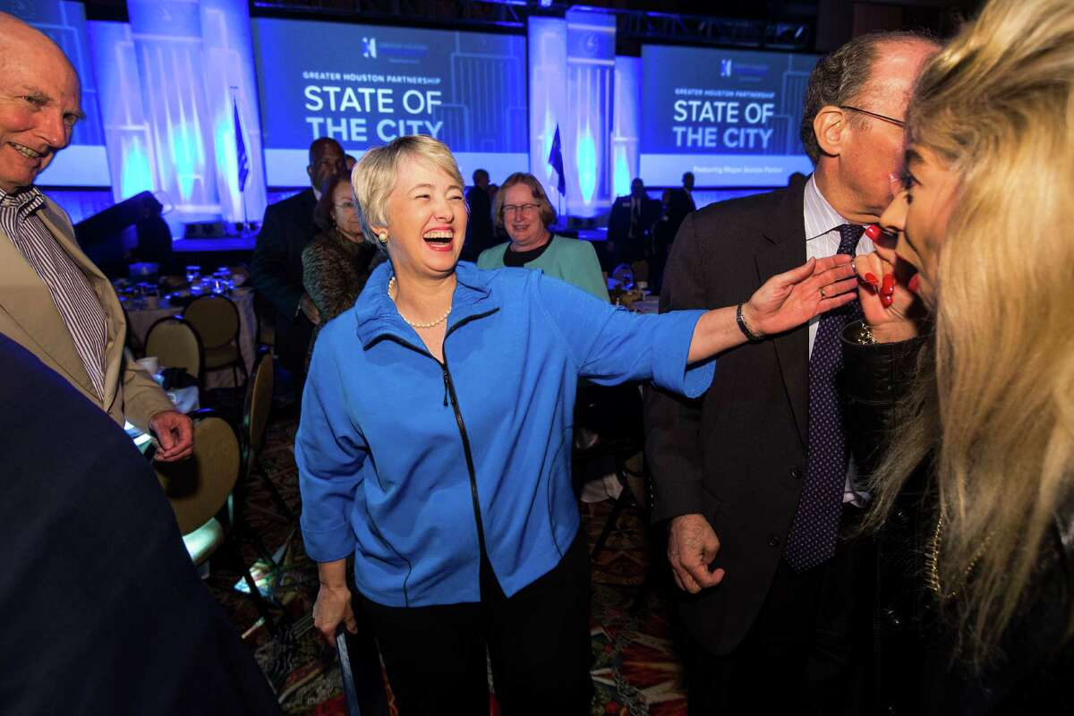 Mayor Annise Parker greets supporters after her speech. She put a spotlight on her own successes and warned mayoral candidates of what the job requires as they jostle to replace her.