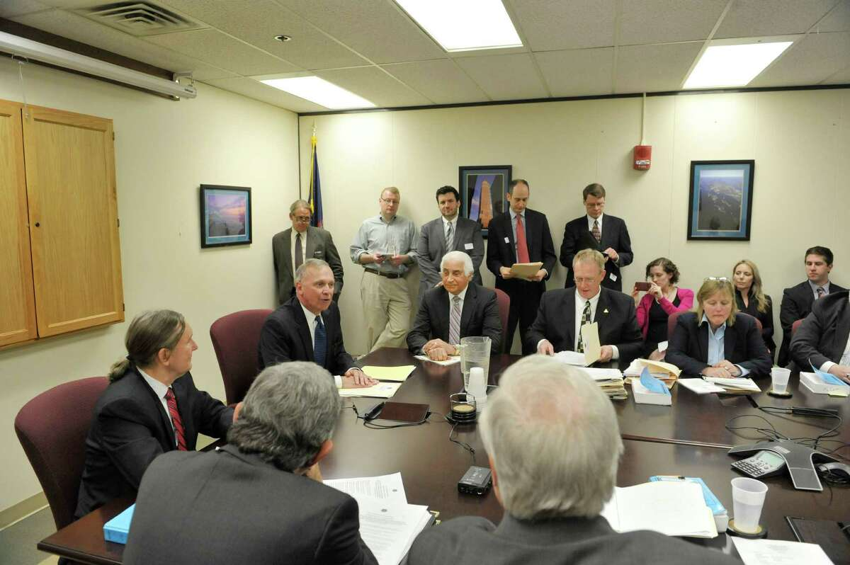 State Board of Elections, Democrat co-chair, Douglas Kellner, on left at head of table, and GOP co-chair Peter Kosinski, on right at head of table, take part in a board meeting with commissioners and staff on Thursday, April 16, 2015, in Albany, N.Y. (Paul Buckowski / Times Union)