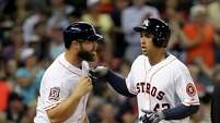 It has been a slow start to the season for the Astros' Evan Gattis, left, and George Springer, who are hitting .094 and .147, respectively.