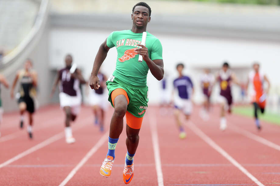 Sam Houston's Jonathan Challenger crosses the finish line of the 400-meter relay during the finals of the running events in the District 28-5A track and field meet at Alamo Stadium on Thursday, April 16, 2015.  The Hurricanes won the event with a time of 42.14 seconds.  MARVIN PFEIFFER/ mpfeiffer@express-news.net Photo: Marvin Pfeiffer, Staff / San Antonio Express-News / Express-News 2015