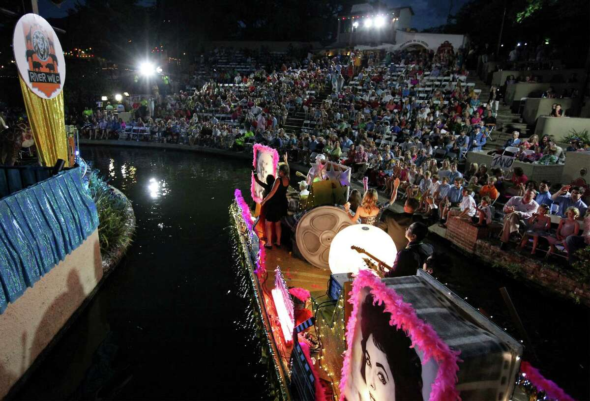 """The Down Syndrome Association of South Texas' """"Holly-Wild"""" float passes through the Arneson River Theatre during the 2014 Texas Cavaliers River Parade """"River Wild"""" on April 21, 2014."""