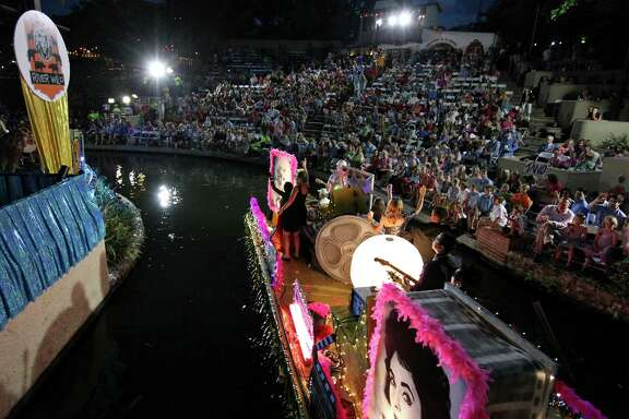 "The Down Syndrome Association of South Texas' ""Holly-Wild"" float passes through the Arneson River Theatre during the 2014 Texas Cavaliers River Parade ""River Wild"" on April 21, 2014."