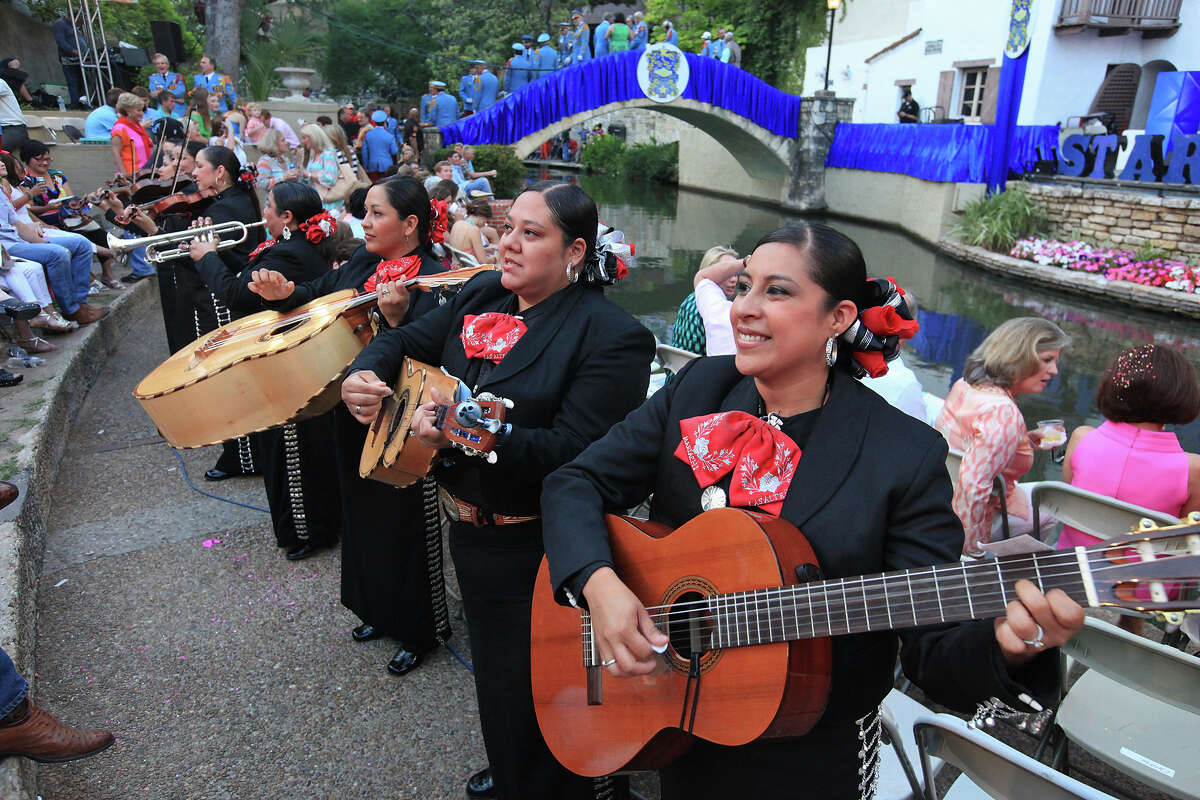 """Mariachi Las Alteñas performs before the Texas Cavaliers River Parade """"Stars on the River"""" on April 22, 2013."""