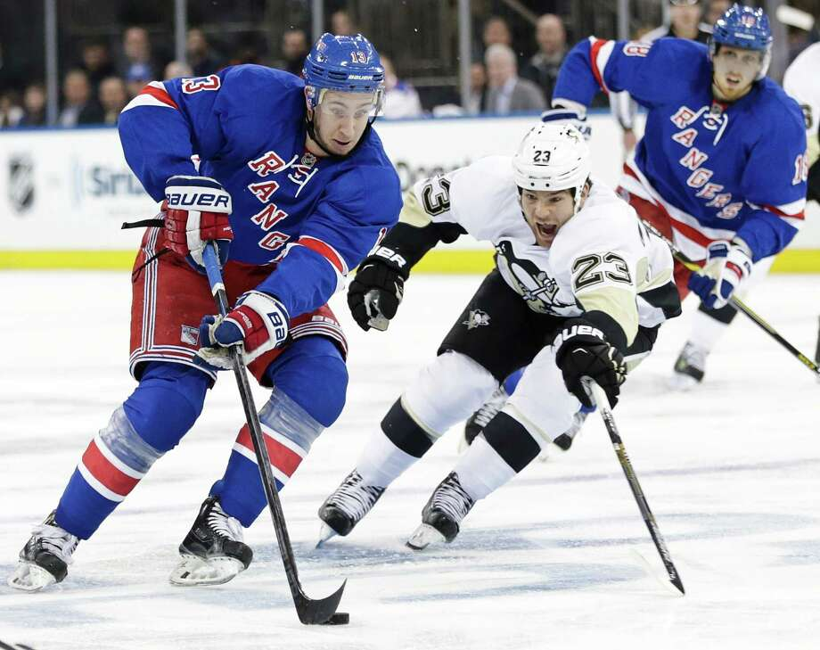 Pittsburgh Penguins' Steve Downie (23) fights for control of the puck with New York Rangers' Kevin Hayes (13) during the second period of Game 1 in the first round of the NHL hockey Stanley Cup playoffs Thursday, April 16, 2015, in New York.  (AP Photo/Frank Franklin II) ORG XMIT: MSG109 Photo: Frank Franklin II / AP