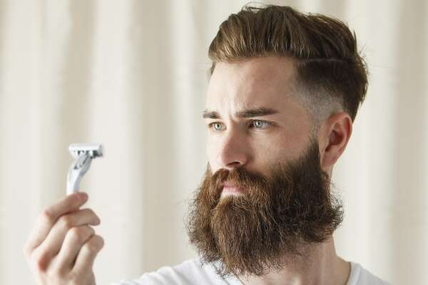 Beware of men with pale, shaved faces (as in, you recently shaved off your terrorist beard).