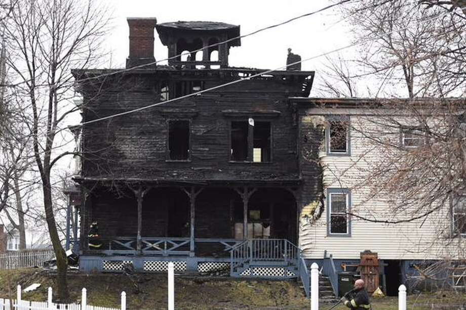 Fire severely damaged an apartment house early Friday April 17, 2015, on Mohawk Street in Cohoes. (Skip Dickstein/Times Union)