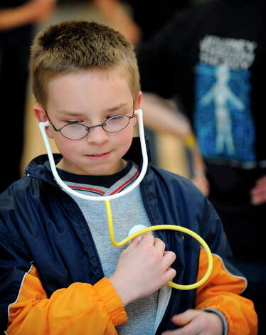 Josh Fuller 11, of Johnstown listens to his heart during the St. Peter's Health Care Services sponsored Journey Through The Body today at Colonie Center in Colonie, New York April 11, 2008. (Skip Dickstein/Times Union archive) Photo: SKIP DICKSTEIN / ALBANY TIMES UNION