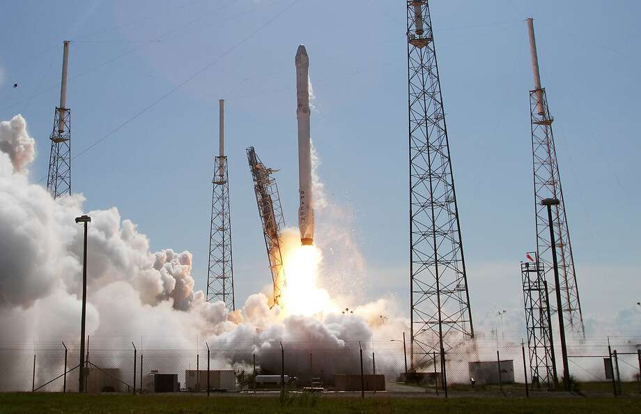 A Falcon 9 rocket and Dragon spacecraft blast off  from Cape Canaveral Air Force Station on a re-supply mission to the International Space Station on April 14, 2015 in Cape Canaveral, Fla. This is Space X sixth official Commercial Resupply Services mission to the orbiting lab. (Red Huber/Orlando Sentinel/TNS) Photo: Red Huber, McClatchy-Tribune News Service