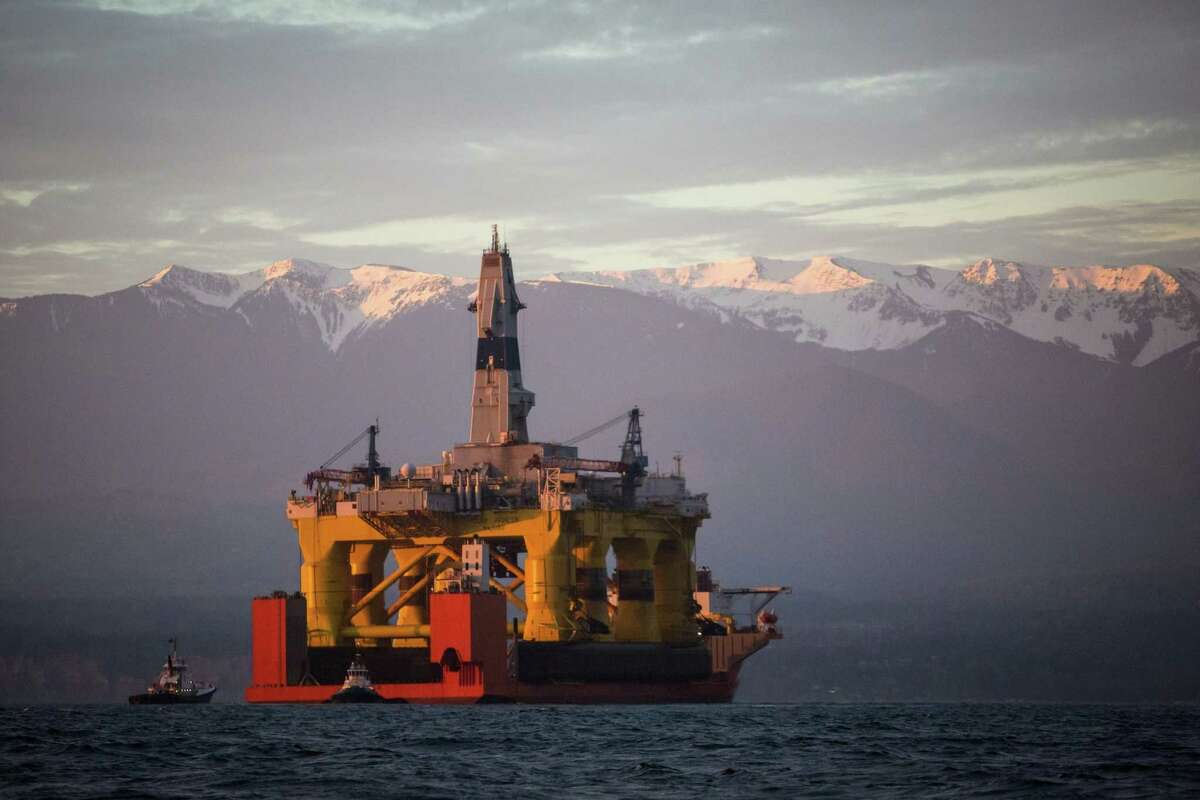 The Shell Oil rig Polar Pioneer enters the Port Angeles Harbor while riding atop the Blue Marlin on Friday, April 17, 2015. The controversial oil rig will stay in Port Angeles for two weeks before heading to Seattle.