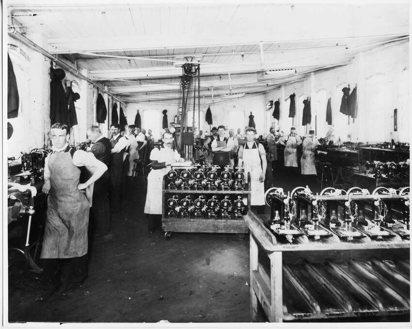 Workers stand inside the factory floor in the Wheeler and Wilson Sewing Machine Factory in Bridgeport. In 1856, the company moved from Watertown into the empty Jerome Clock factory on East Washington Avenue. Founded by Allen B. Wilson, who patented a new kind of sewing machine in 1850, and Nathaniel Wheeler, who provided capital for the project, the factory employed over 1,000 people at one time. It was taken over by the Singer Corporation in 1905, after the deaths of its founders. Photo is courtesy of the Public LibraryâÄôs Bridgeport History Center.