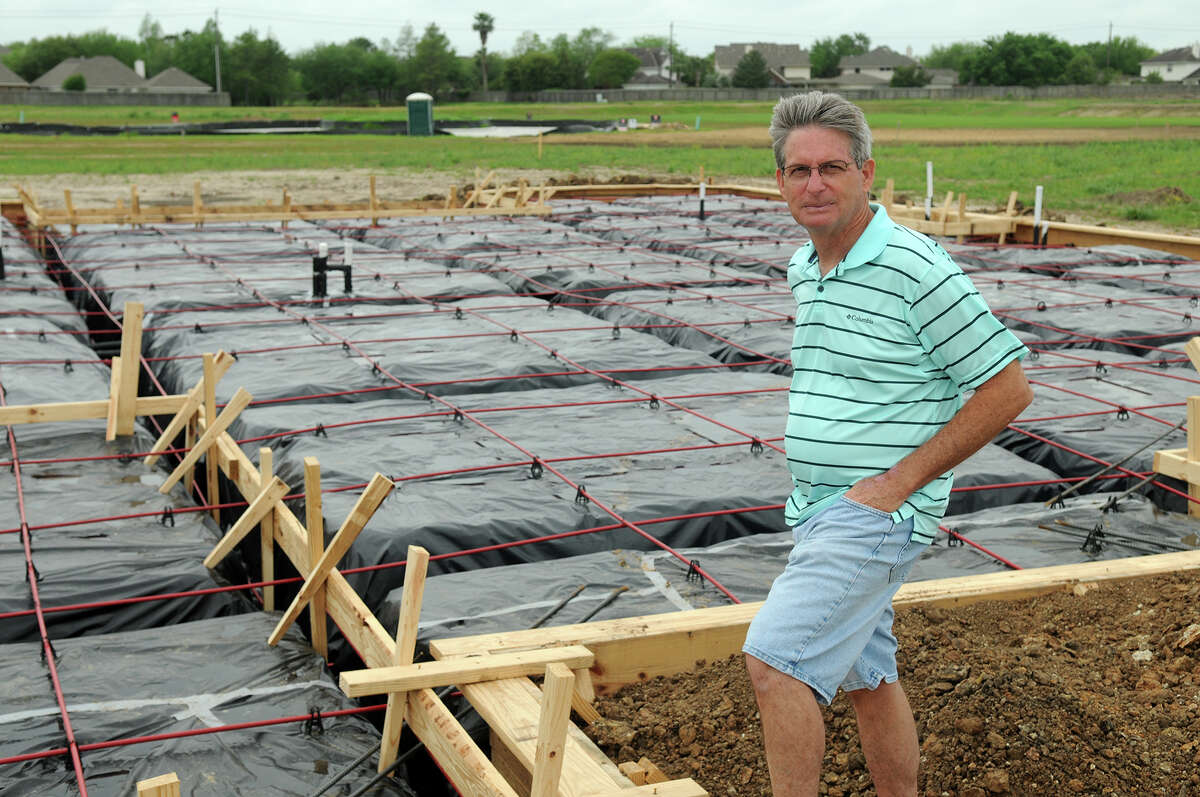 Mark Parks, a 1970 graduate of Clear Creek High School and presently a resident of Friendswood with his wife Tamra, stands at the site of the couple's new home being built in The Reserve at Clear Lake City, located at Clear Lake City Road and El Dorado Blvd.