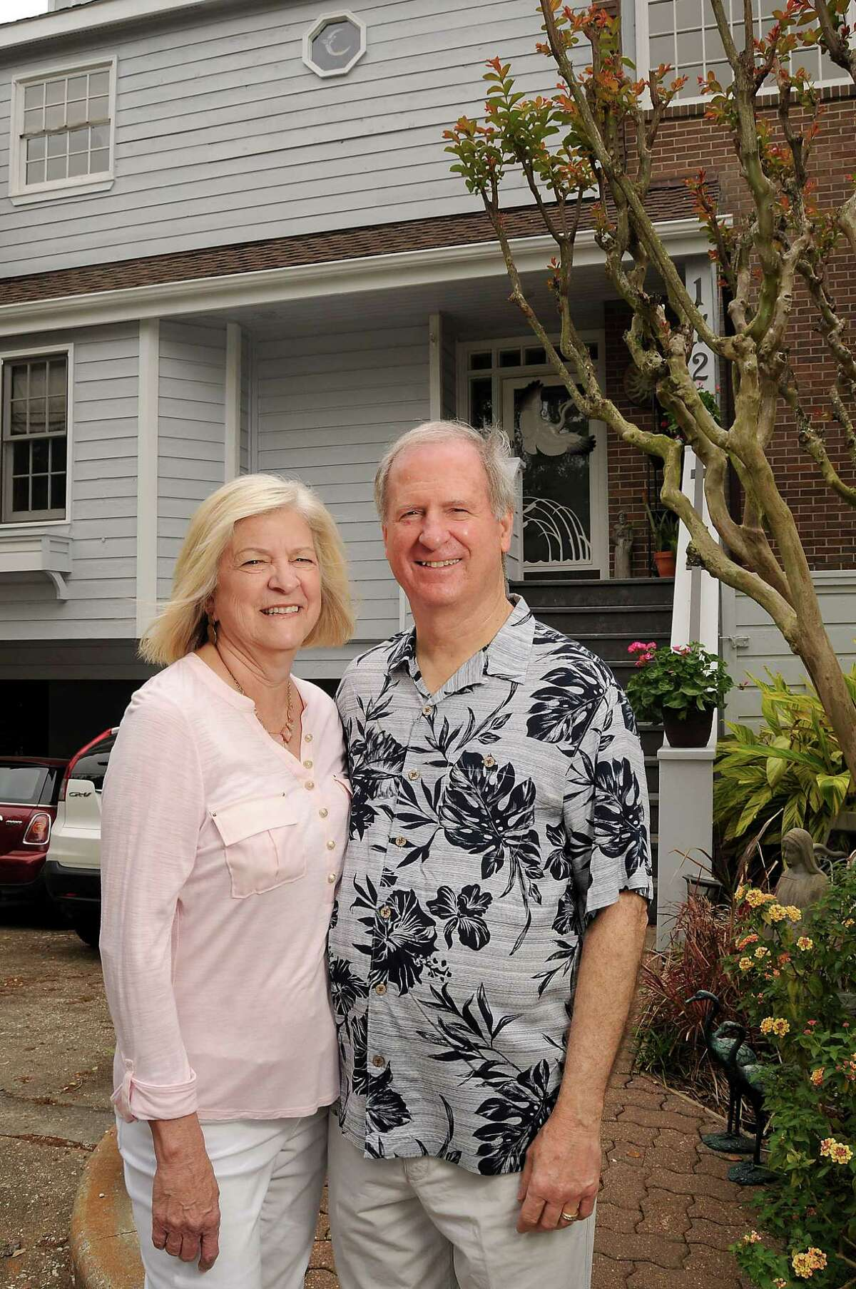 Pat and Richard Maddox in front of their new town house on Enterprise Ave in League City Saturday April 04, 2015.(Dave Rossman photo)