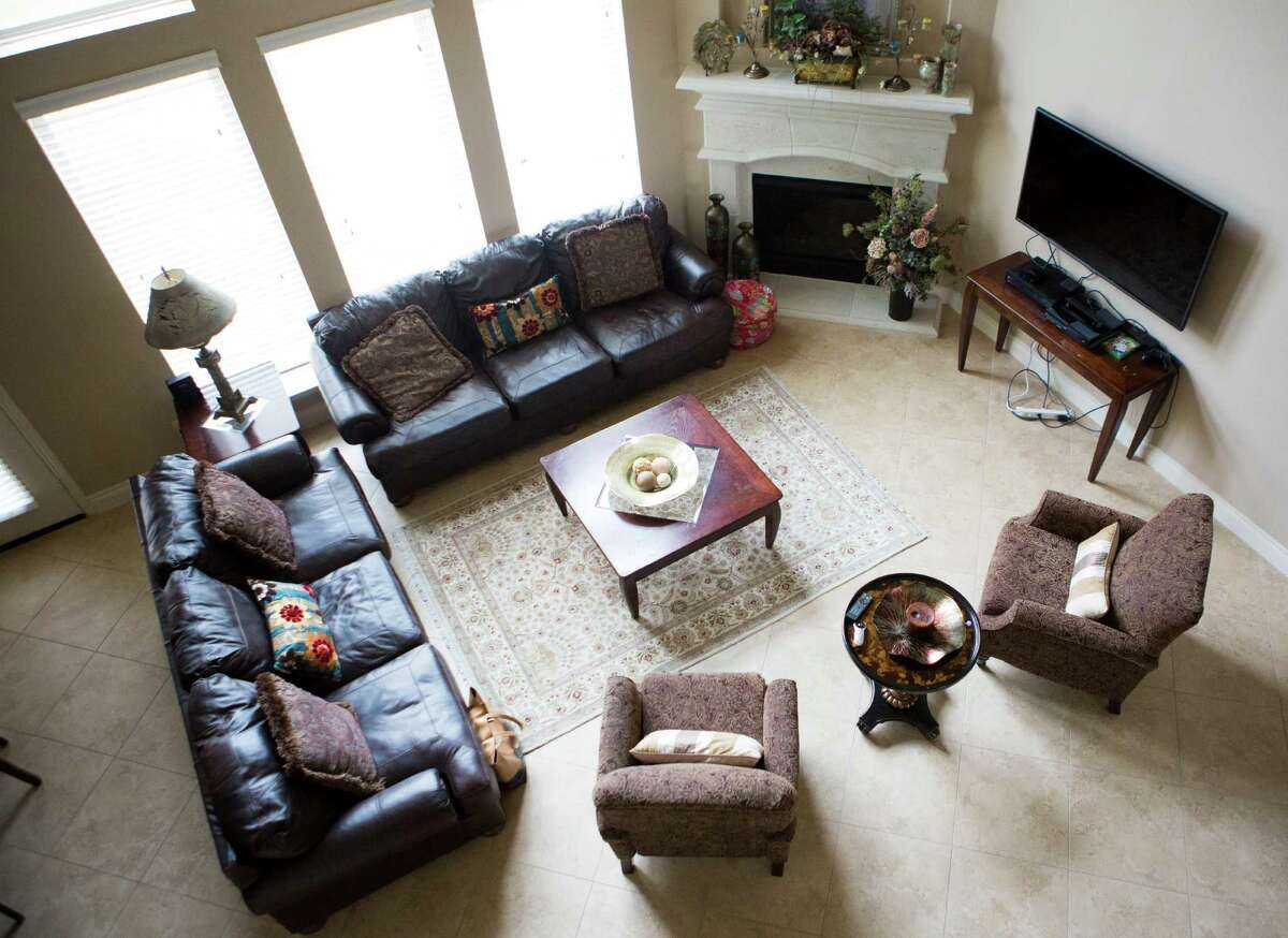 View of the formal living room of Chad Ahmad's home in Sugar Land. The family moved from Canada to Sugar Land last year in search for a town that could provide good schools and affordable comfortable home. Friday, April 3, 2015, in Sugar Land.