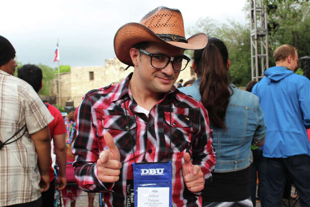 Revelers mark the beginning of Fiesta San Antonio at Fiesta Fiesta in Alamo Plaza on Thursday, April 16, 2015.