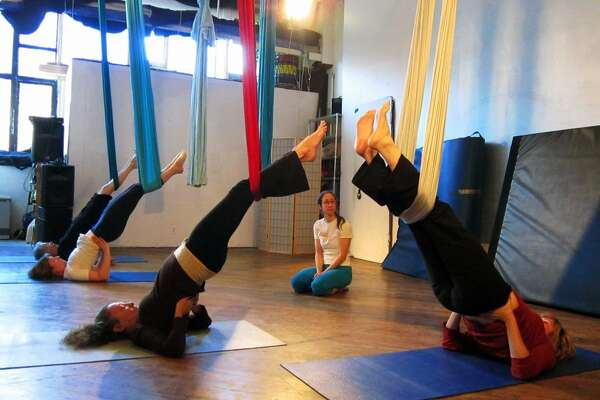 Fitness Trainer/Aerobics Instructor Fitness Trainer/Aerobics Instructor Unnata Aerial Yoga Median hourly earnings: $15.88 Job growth from 2010-2014: 8% BLS job description: Instruct or coach groups or individuals in exercise activities. Demonstrate techniques and form, observe participants, and explain to them corrective measures necessary to improve their skills. Read more: http://www.businessinsider.com/high-paying-jobs-for-people-who-dont-want-to-sit-at-a-desk-2015-4?op=1#ixzz3XaimrpI9