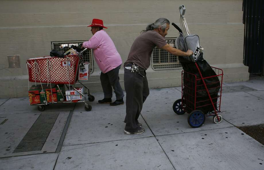 Armed with a pair of vacuum cleaners in need of maintenance, vacuum collector Leonard Low heads home to his apartment in San Francisco, Calif. Photo: Mike Kepka, The Chronicle