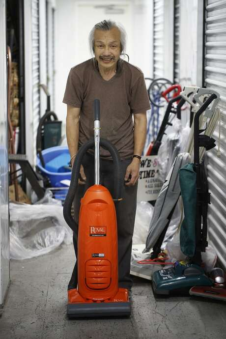 Vacuum cleaner collector Leonard Low shows off an orange Royal before putting it back in his storage locker in San Francisco, Calif. Photo: Mike Kepka, The Chronicle