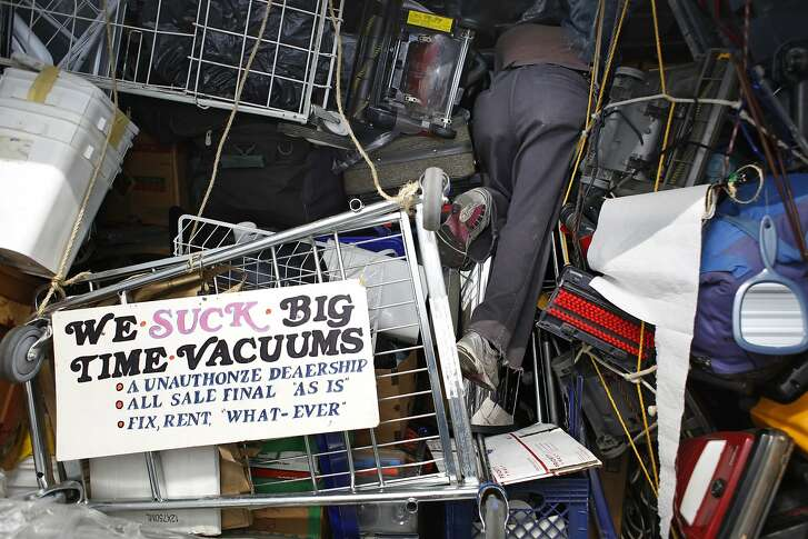 Searching and Oreck upright, vacuum cleaner collector Leonard Low digs through his storage unit in San Francisco, Calif. Low says he has 75-80 vacuum cleaners that he has restored and repaired from the ground up.