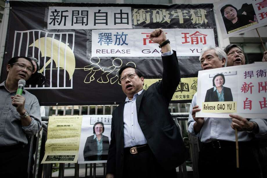 Hong Kong Democratic Party's Albert Ho (C) shouts slogans outside the China liaison office during a protest in support of Chinese journalist Gao Yu in Hong Kong on April 17, 2015.  A Chinese court on April 17, 2015 convicted the 71-year-old journalist of leaking state secrets and jailed her for seven years, it said, in a case seen by rights groups as part of a crackdown on government critics. Photo: PHILIPPE LOPEZ / AFP / Getty Images / AFP