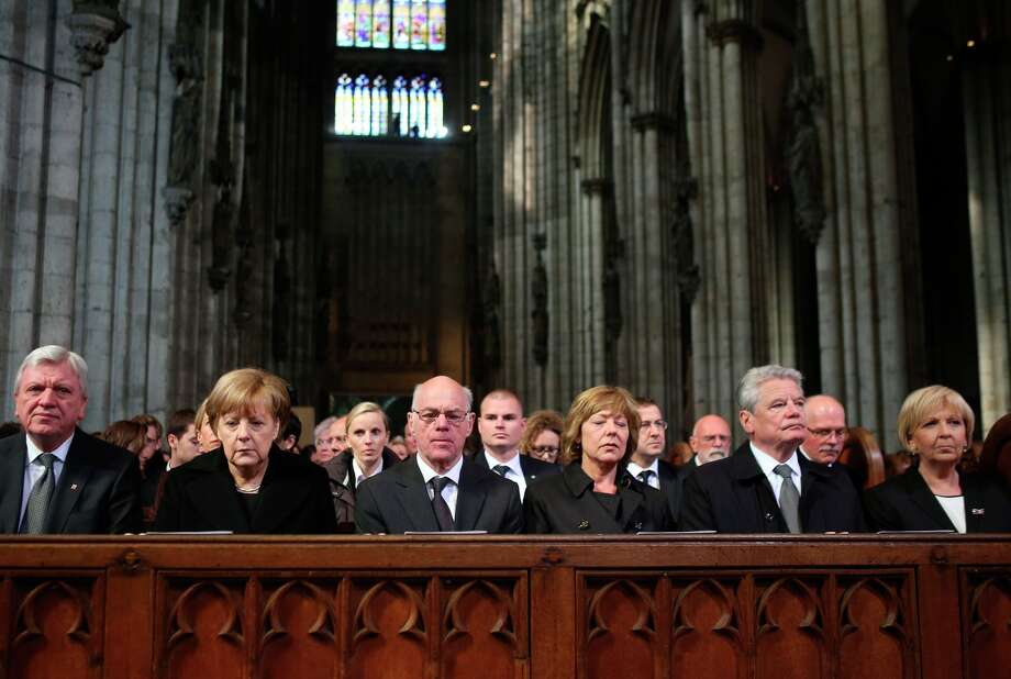 Chancellor Angela Merkel (second from left) is among mourners at the Cologne Cathedral. Photo: OLIVER BERG / AFP / Getty Images / AFP
