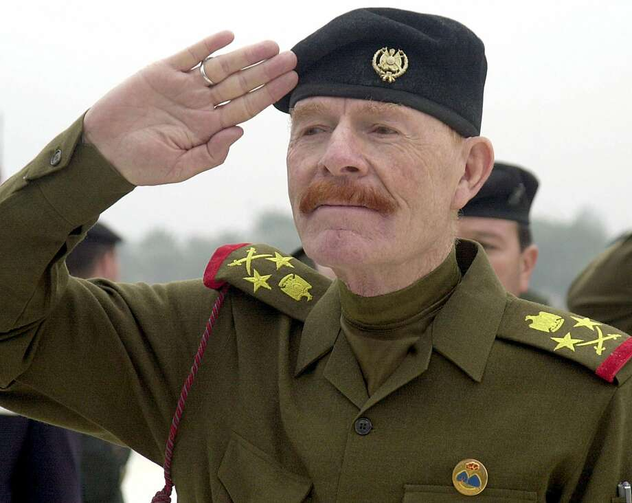 FILE - in this Sunday, Dec. 1, 2002 file photo, Iraqi Vice chairman of the Revolutionary Command Council, Izzat Ibrahim al-Douri salutes during a ceremony at the Martyrs Monument in Baghdad, Iraq. Salahuddin province Gov. Raed al-Jabouri says soldiers and allied Shiite militiamen killed al-Douri early Friday, April 17, 2015 in an operation east of the city of Tikrit. A graphic photo issued by the government purports to be of al-Douri's corpse, but DNA tests are still pending. (AP Photo/Jassim Mohammed, File) Photo: Jassim Mohammed, Associated Press